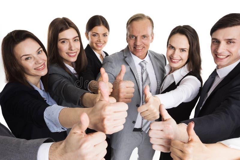 Affärsfolk som visar upp tummen arkivbild