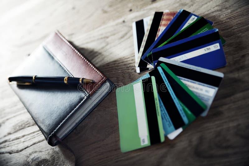 Affärsfortfarande-liv-anteckningsbok och penna royaltyfri foto