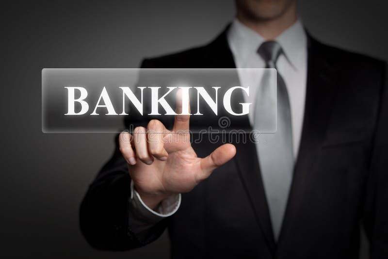 Affärsidé - affärsman trycker på den faktiska pekskärmknappen - engelskt ord BANKRÖRELSE royaltyfri foto