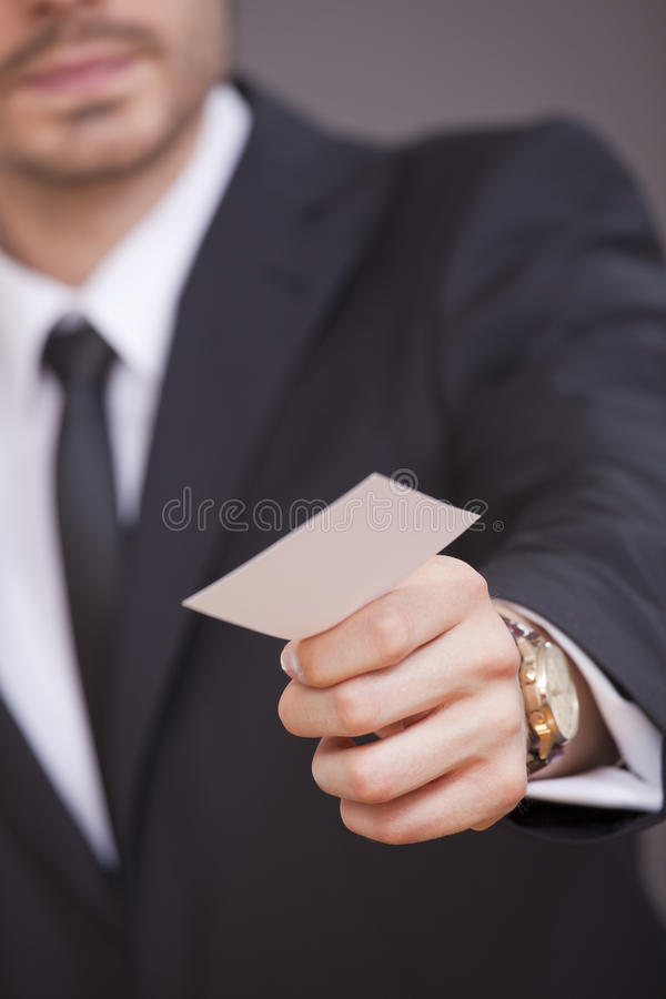 affärskort som ger mannen arkivbild