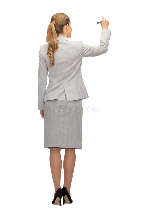 Affärskvinna eller lärare med markören från baksida arkivbild