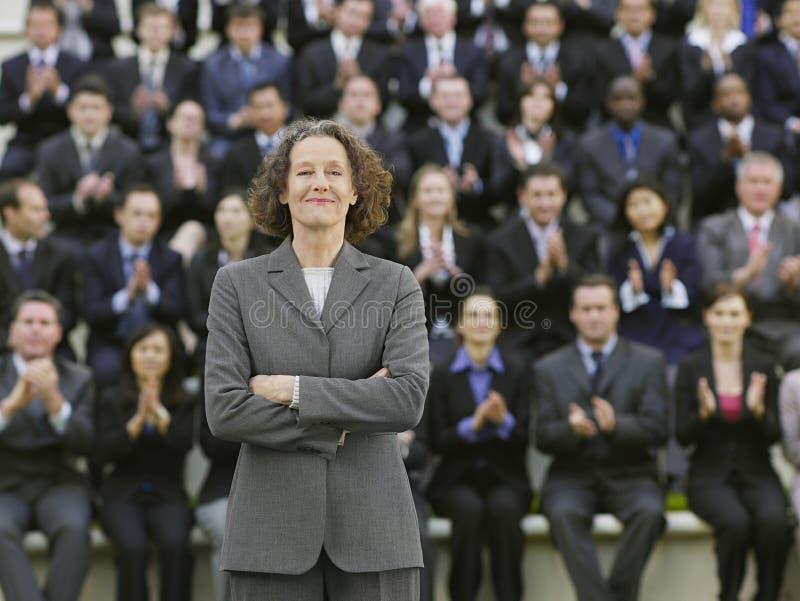 Affärskvinna In Front Of Multiethnic Executives royaltyfri fotografi