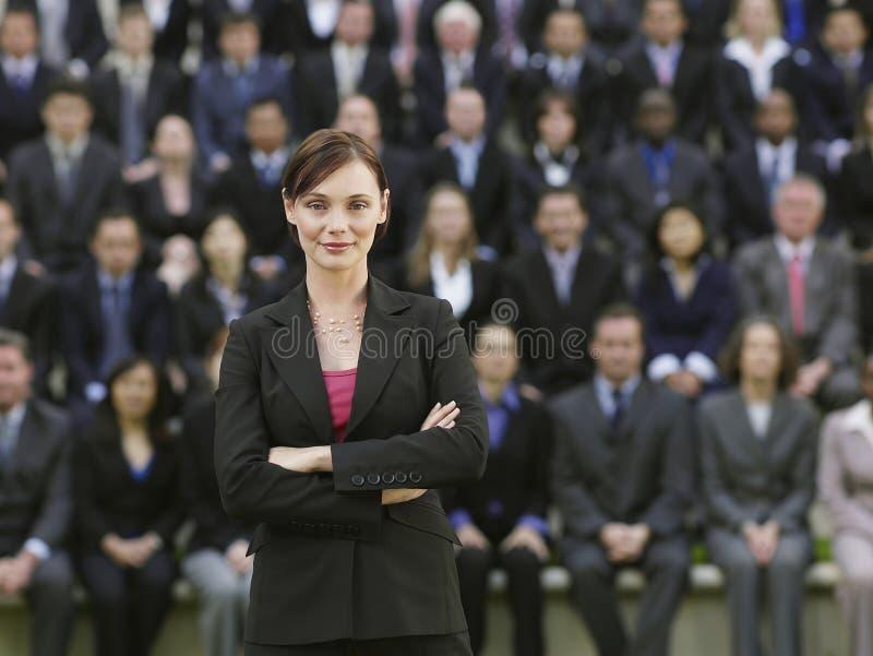 Affärskvinna In Front Of Multiethnic Executives arkivfoton