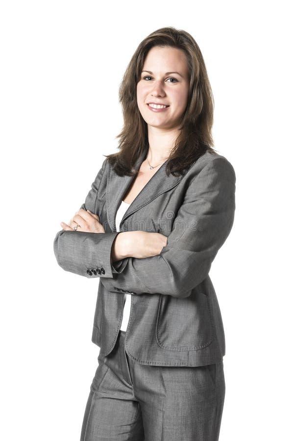 Affärskvinna i grå färgdräkt royaltyfri bild