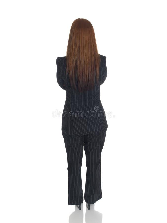 Affärskvinna - korsade tillbaka armar fotografering för bildbyråer