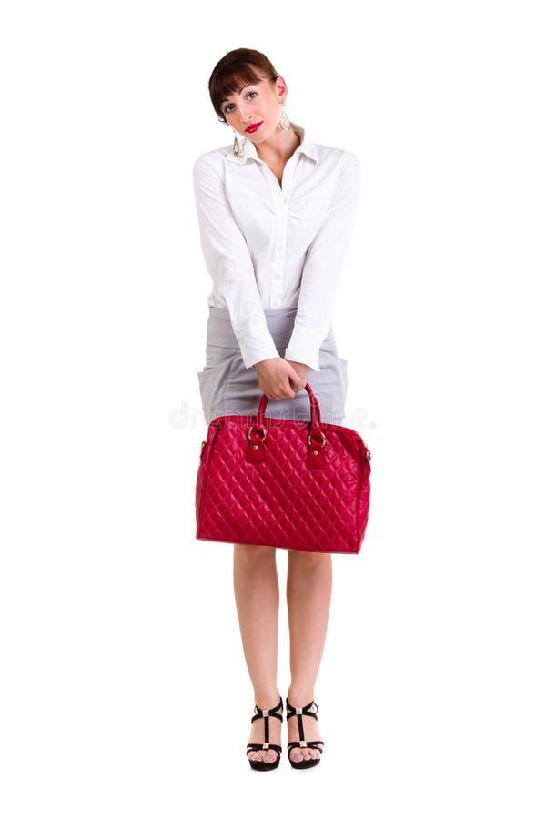 Affärskvinna med den röda handväskan royaltyfria foton