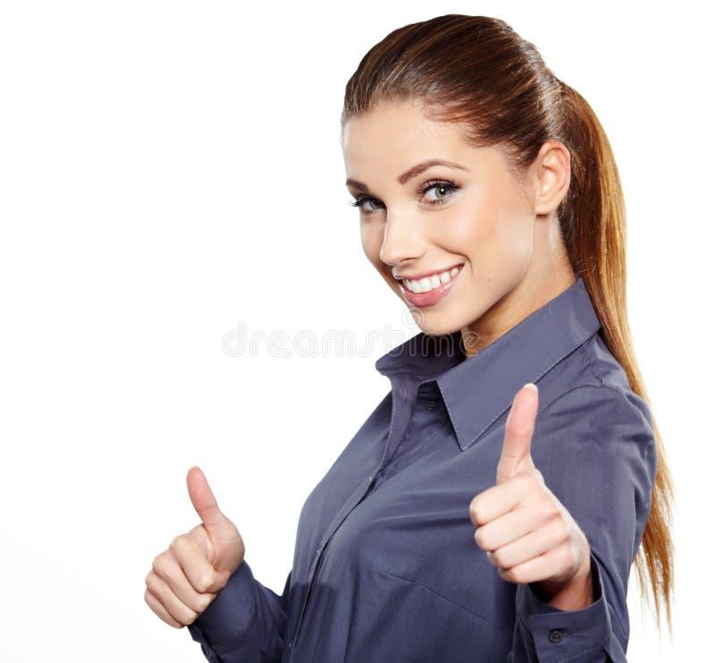 Affärskvinna med det ok handtecknet royaltyfria foton