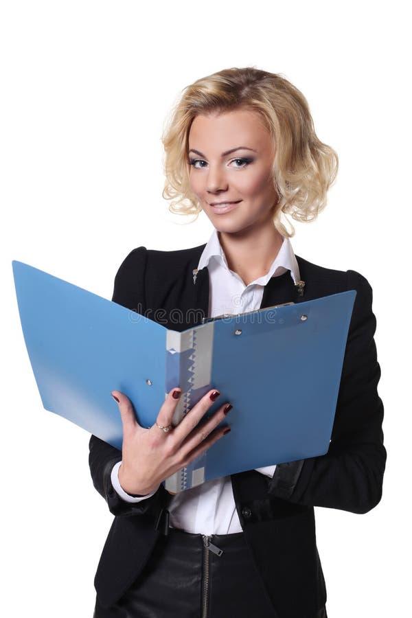 Affärskvinna med en bok som isoleras på vit bakgrund royaltyfri fotografi