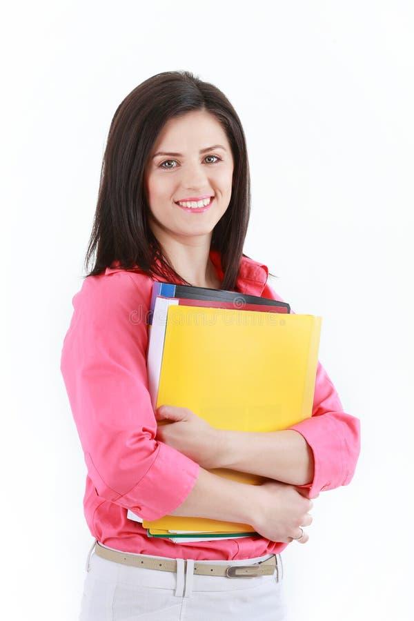 Affärskvinna med färgrika mappar som isoleras på vit backgroun royaltyfria foton