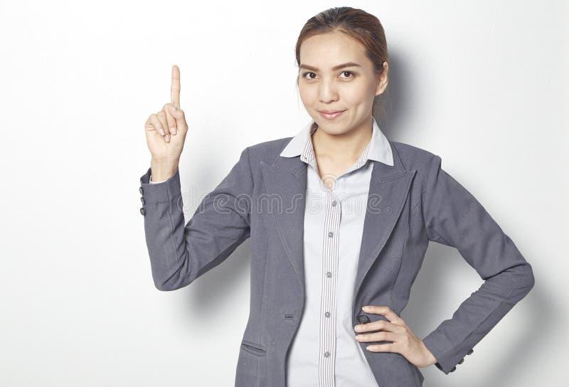 Affärskvinna med fingerpunkt fotografering för bildbyråer