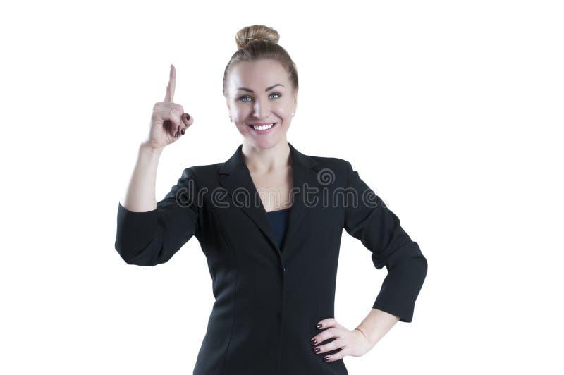 Affärskvinna med fingerpunkt upp royaltyfri fotografi