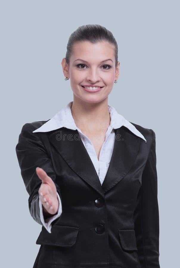 Affärskvinna med hennes arm ut i välkomna arkivfoton
