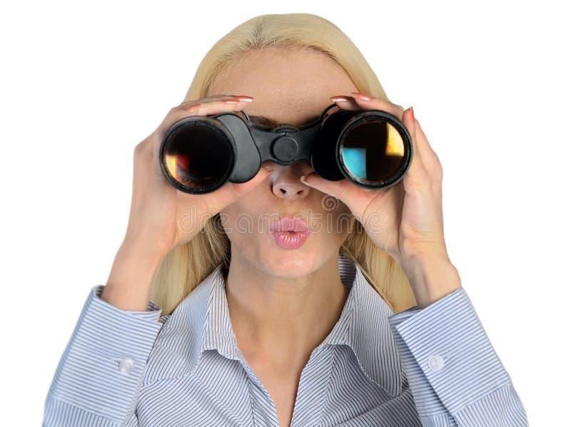Affärskvinna med kikare fotografering för bildbyråer