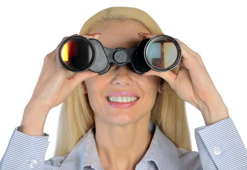 Affärskvinna med kikare arkivbilder