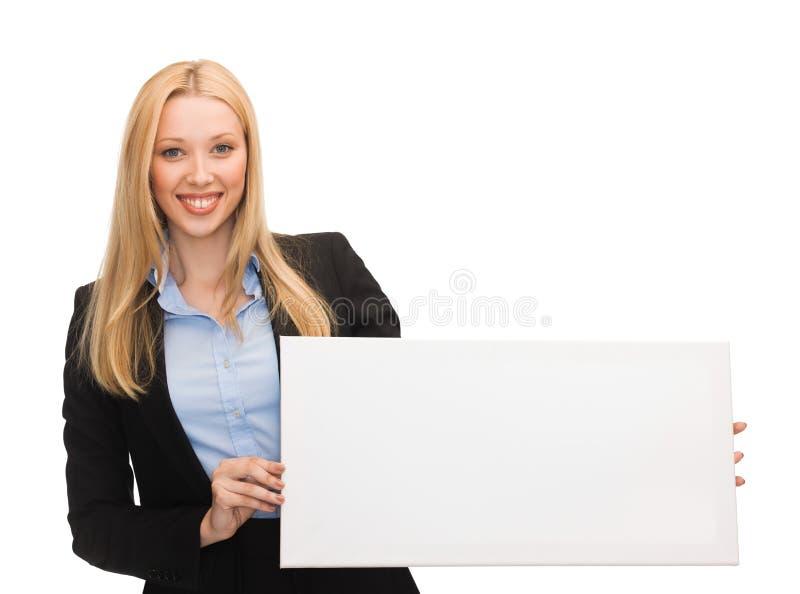 Affärskvinna med vitmellanrumsbrädet royaltyfria bilder