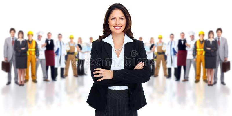 Affärskvinna och grupp av arbetarfolk. royaltyfria bilder