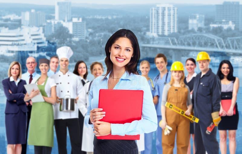 Affärskvinna och grupp av arbetarfolk. royaltyfri foto