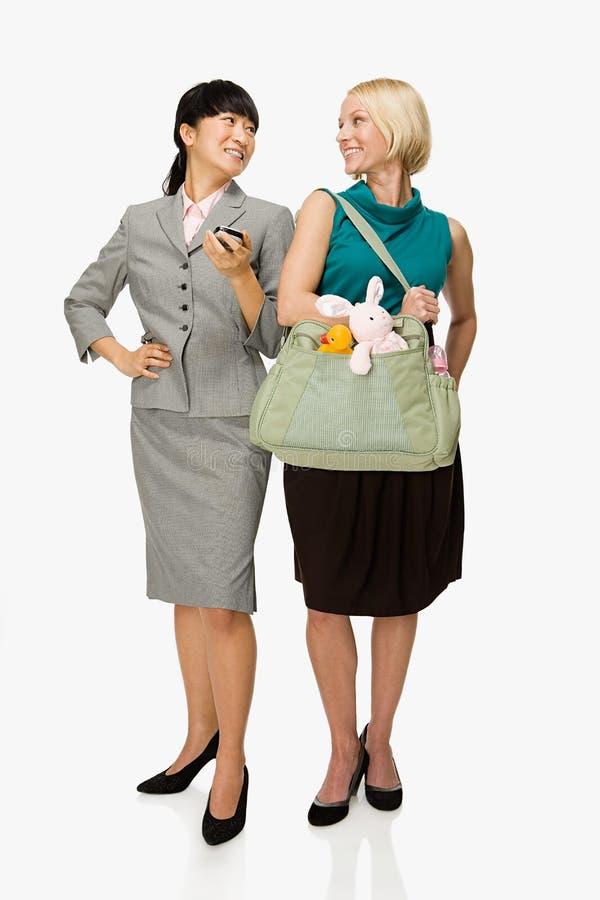Affärskvinna och moder royaltyfri foto