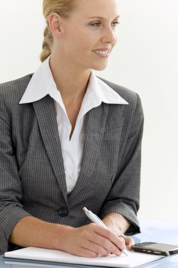 Affärskvinna på ett möte arkivfoton