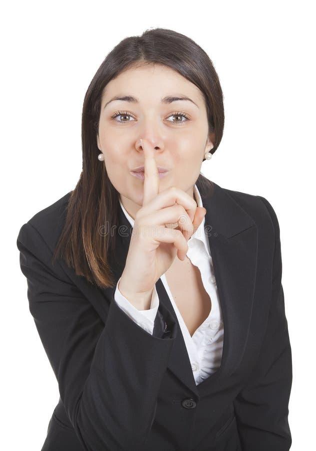 Affärskvinna som gör en gest tystnad arkivbilder