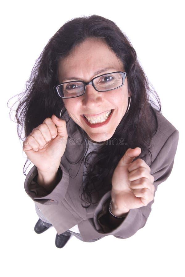 affärskvinna som göra en gest lyckligt le som är mycket ungt arkivfoto