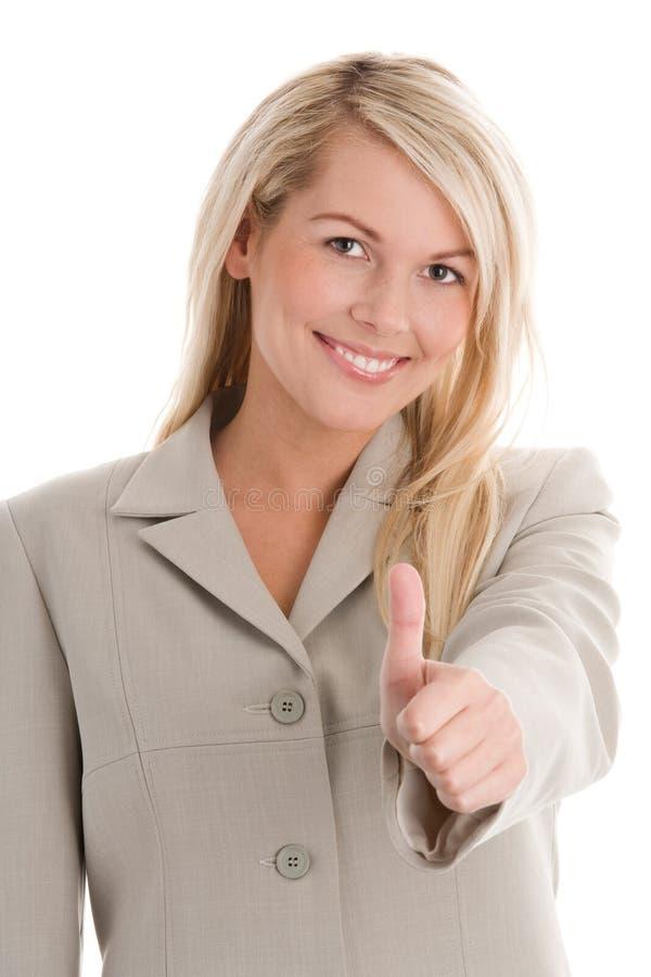 affärskvinna som ger upp tum arkivfoto