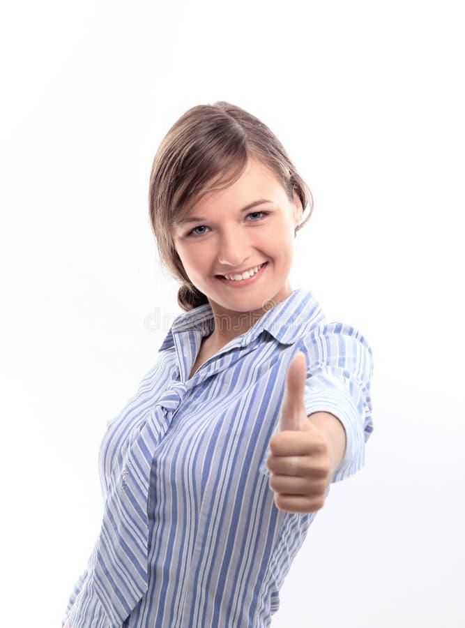 affärskvinna som indikerar det ok tecknet arkivbild