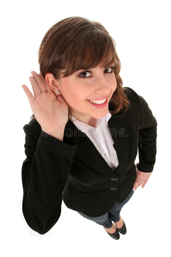 affärskvinna som lyssnar royaltyfri foto