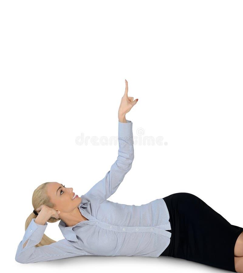 Affärskvinna som pekar upp fotografering för bildbyråer