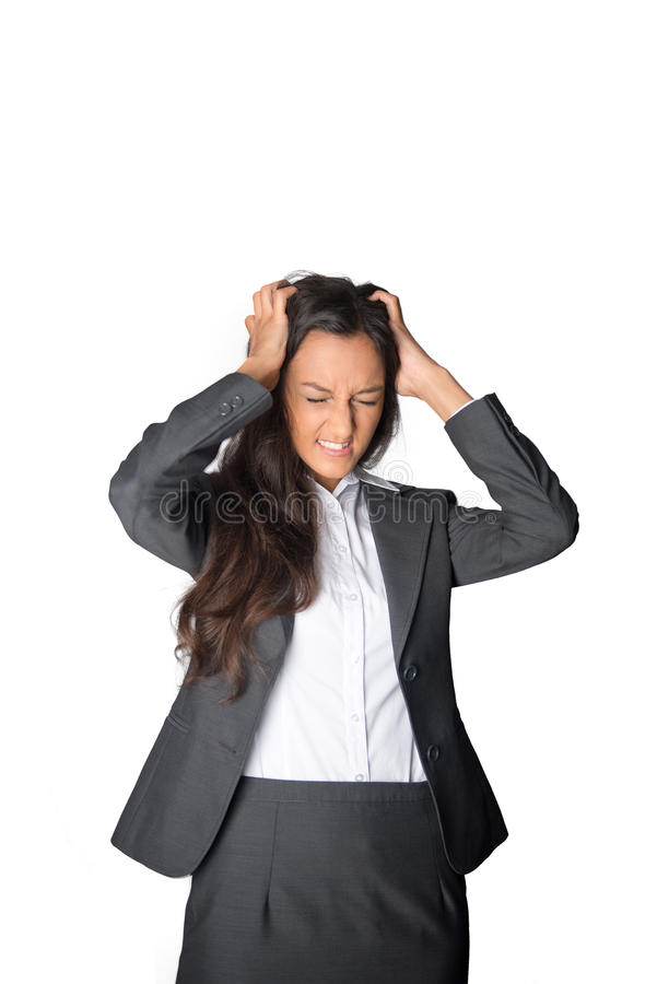 Affärskvinna som river på hennes hår i frustration royaltyfria bilder