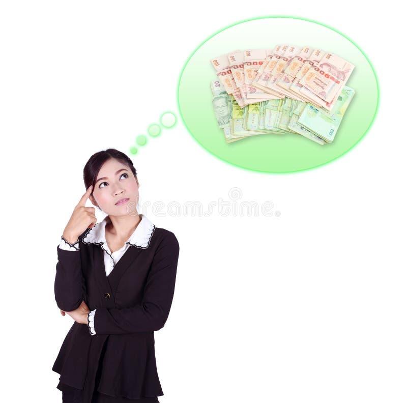 Affärskvinna som tänker om pengar arkivfoton