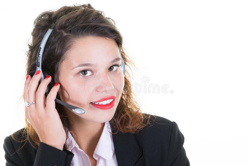 Affärskvinna som talar på operatör för hörlurar med mikrofonappellmitt royaltyfri fotografi
