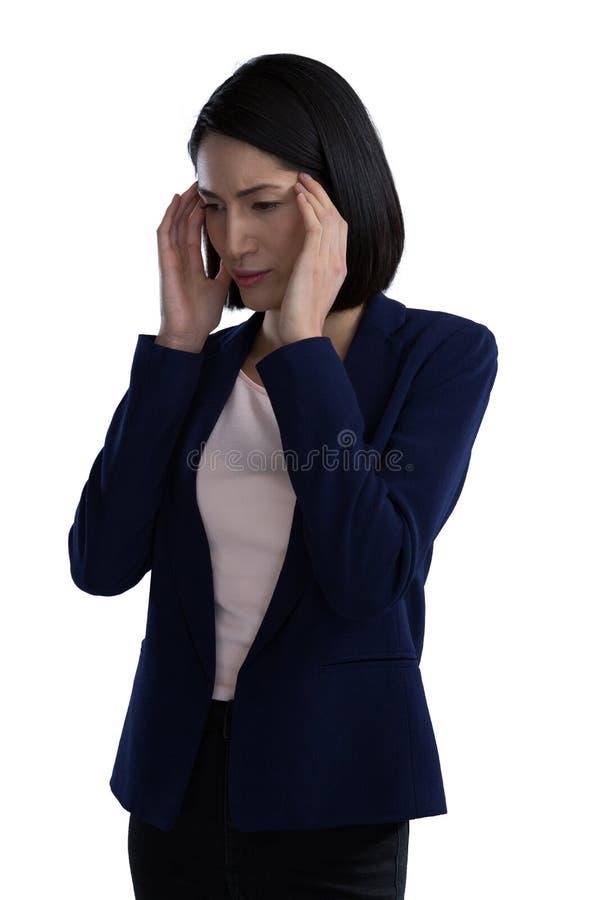 Affärskvinna Suffering From Headache royaltyfria bilder