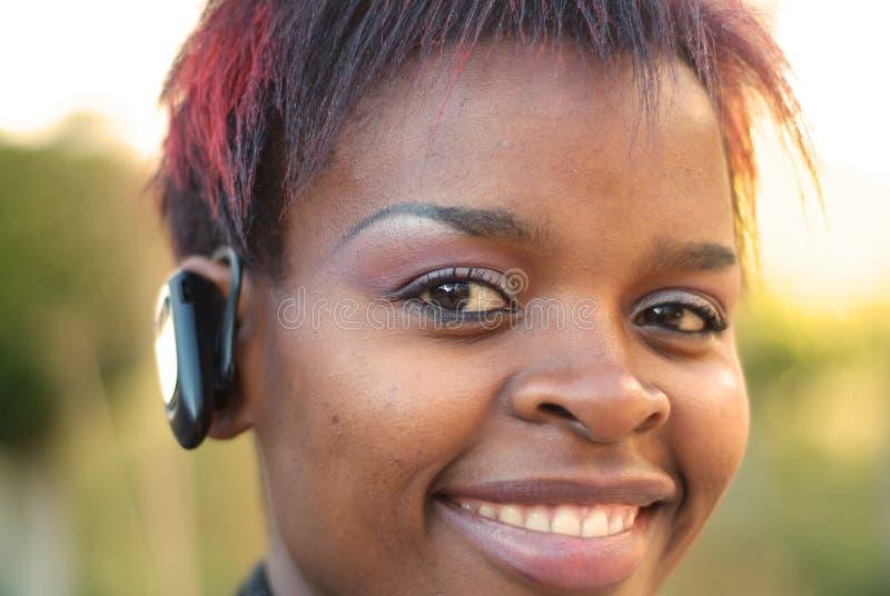 affärskvinnahörlurar med mikrofon royaltyfri fotografi