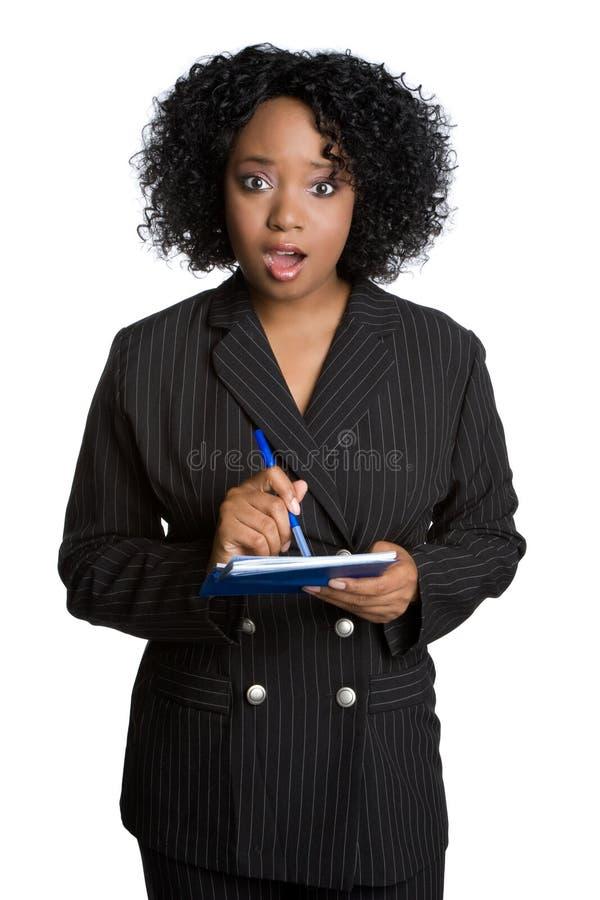 affärskvinnakontrollwriting royaltyfri foto
