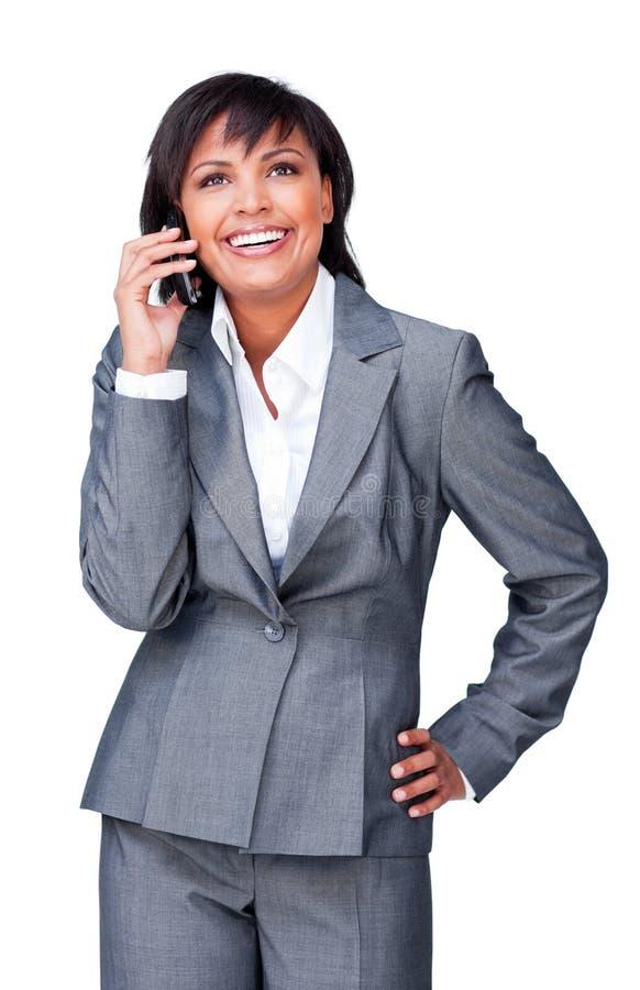 affärskvinnalatinamerikantelefon royaltyfri foto