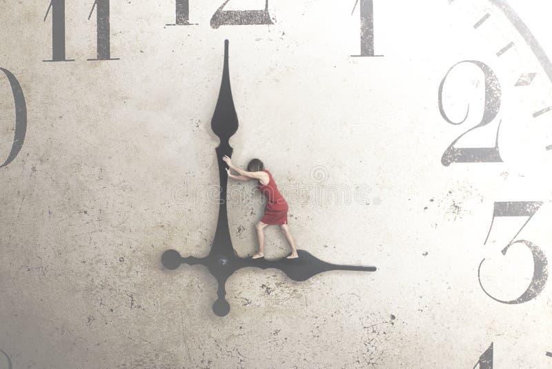 Affärskvinnan försöker att stoppa tiden arkivfoto