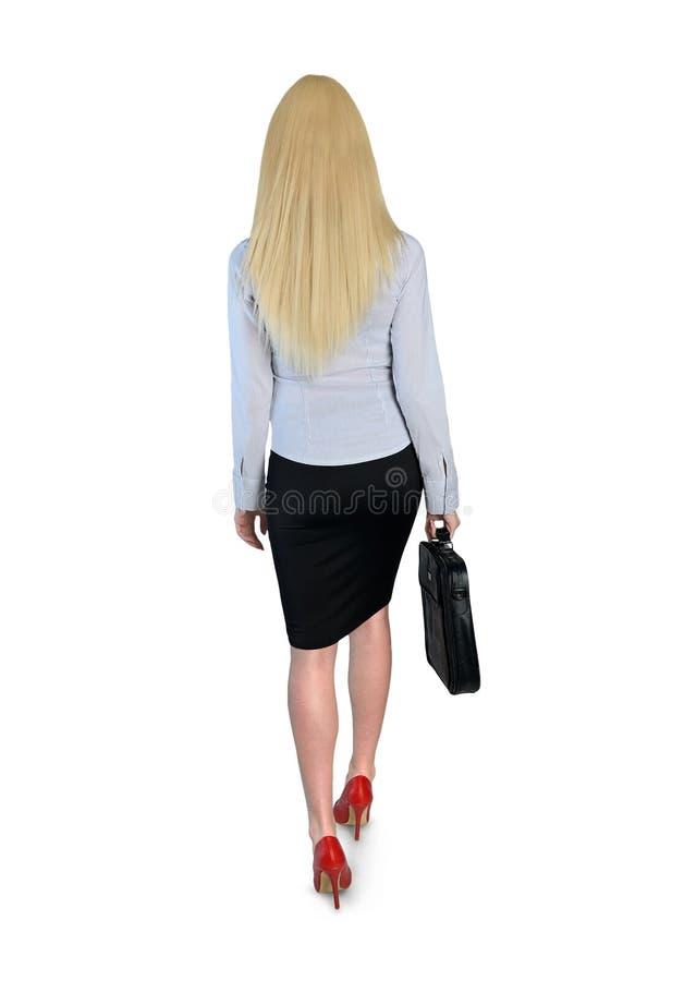 Affärskvinnan går royaltyfria bilder