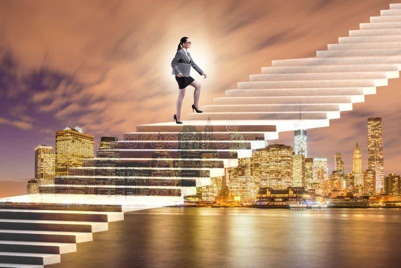 Affärskvinnan i ambition- och beslutsamhetbegrepp royaltyfri bild