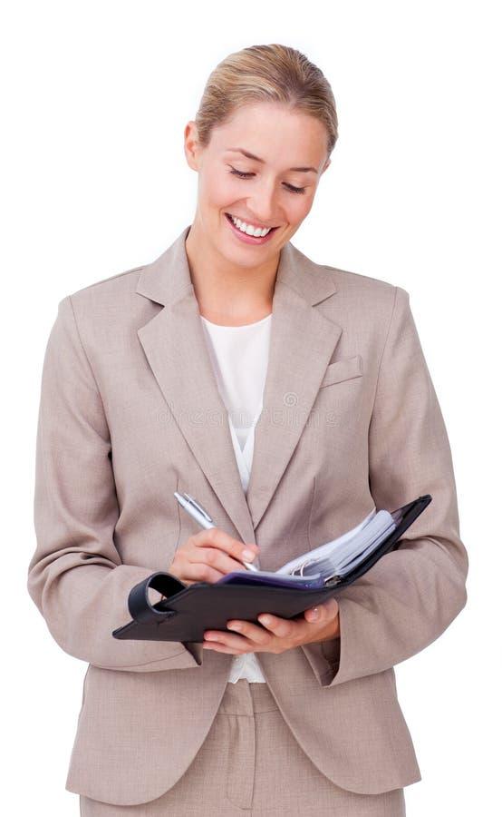 Affärskvinnawriting arkivfoton