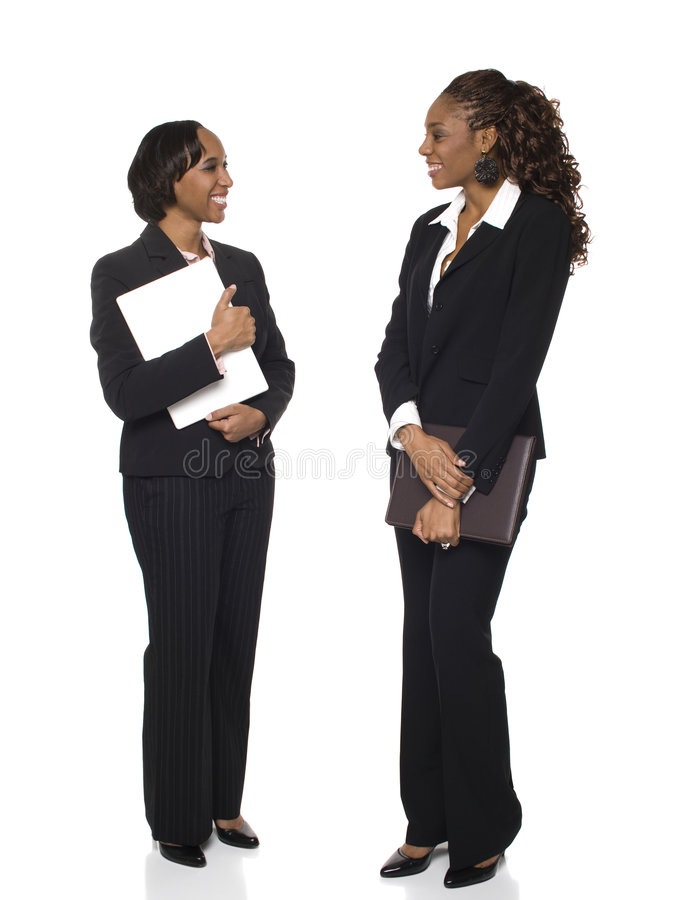 Affärskvinnor - prata royaltyfri foto
