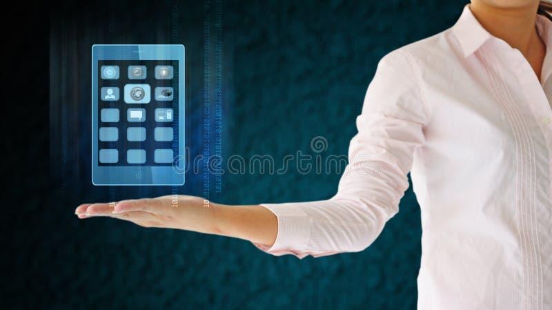 Affärskvinnor som rymmer mobiltelefonen royaltyfri fotografi