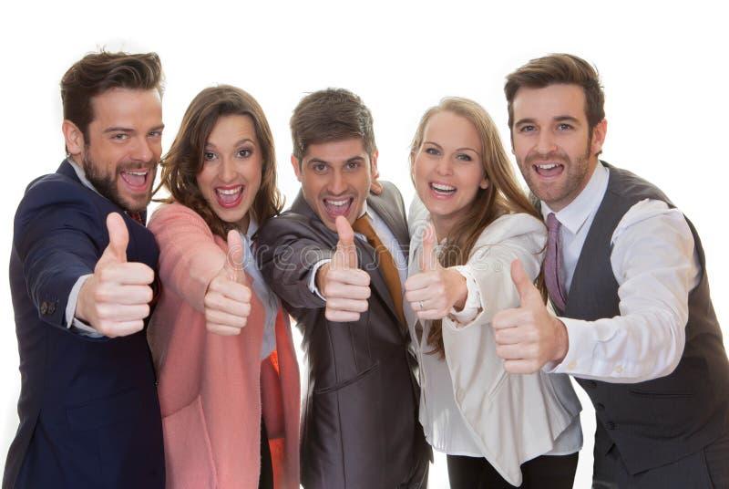 Affärslaggrupp med tummar upp royaltyfri foto