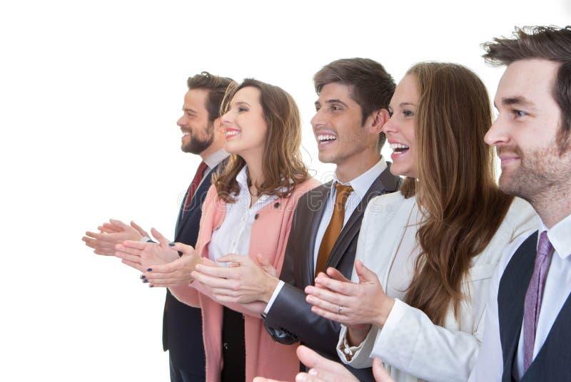 Affärslaggrupp som applåderar i möte royaltyfri bild