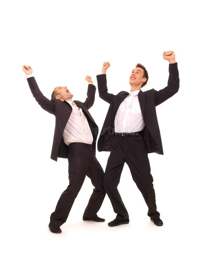 affärsmän lyckliga två arkivfoton