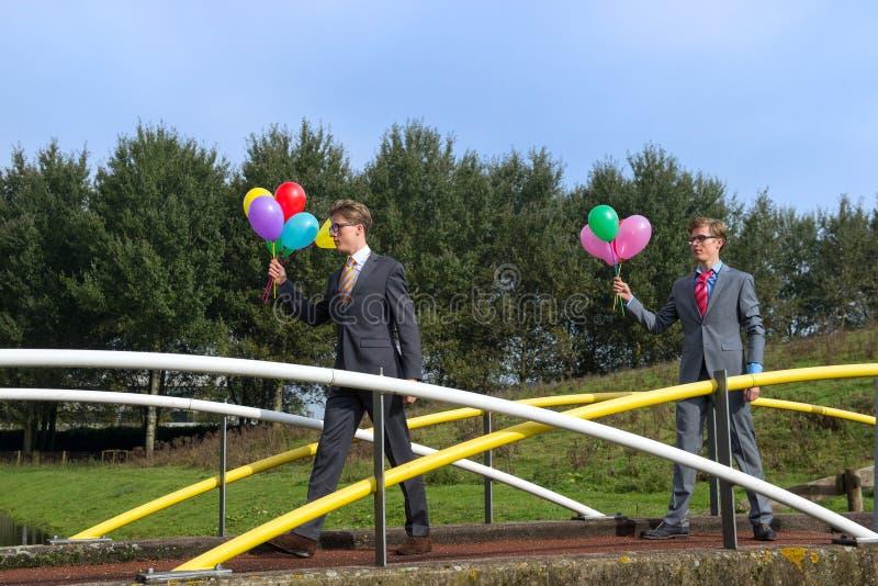 Affärsmän med ballonger royaltyfria foton