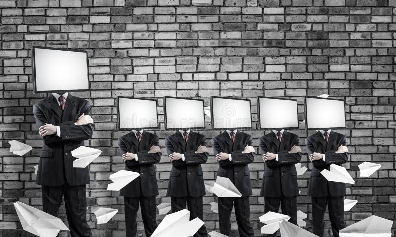 Affärsmän med TV i stället för huvudet royaltyfria foton