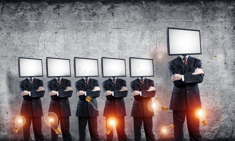 Affärsmän med TV i stället för huvudet royaltyfria bilder