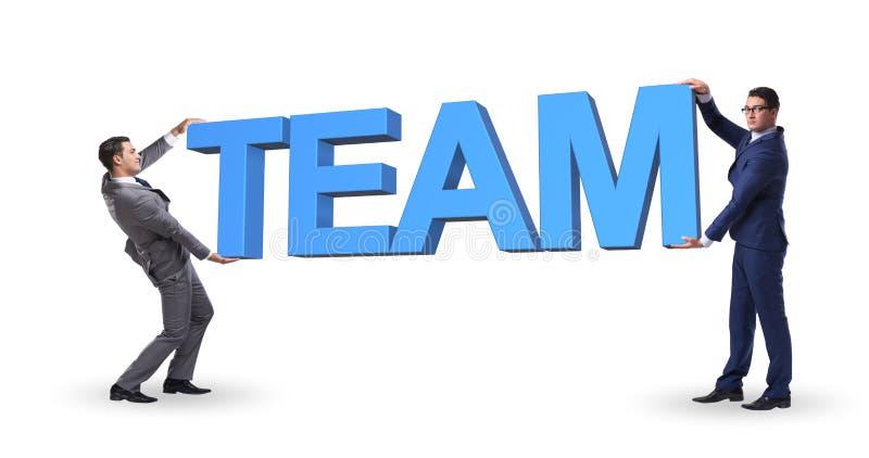 Affärsmännen som rymmer ord, team i teamworkbegrepp arkivfoton