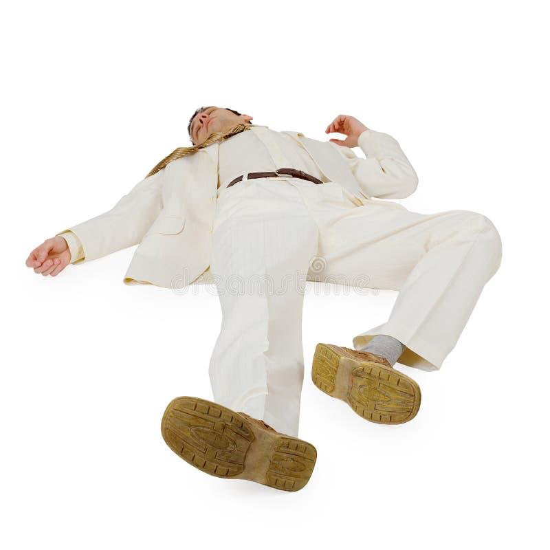 affärsman besegrad liggande white fotografering för bildbyråer